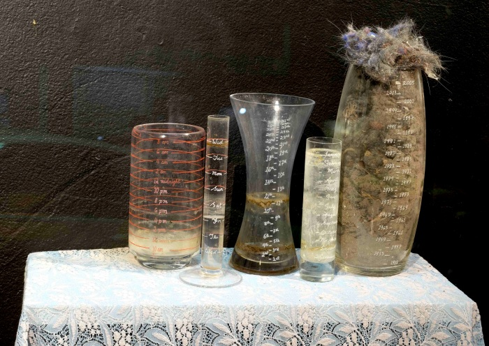 Accumulation Calendar (etched glass time measuring vessels, dust, unidentifiable liquids)