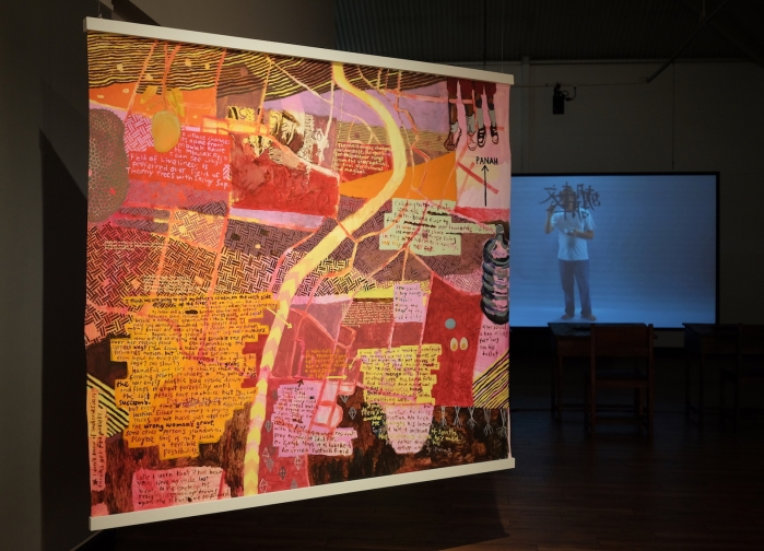 Ida Lawrence, A village and surrounds III (kehidupan baru) 2019 acrylic on unstretched canvas, 160x185cm. (Right) FX Harsono, Writing in the Rain 2011, video installation. Photo Ida Lawrence.JPG